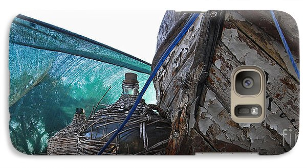 Galaxy Case featuring the photograph Old Boat And Flagons by Andy Prendy