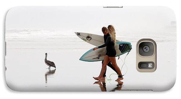 Galaxy Case featuring the photograph Surfers And A Pelican by Alice Gipson