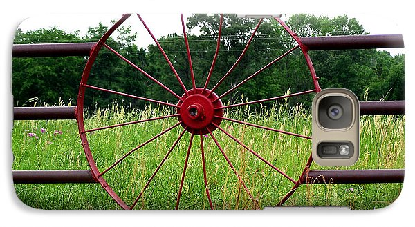 Galaxy Case featuring the photograph Texas Wildflowers Through Wagon Wheel by Kathy  White