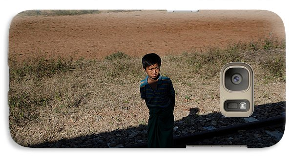 Galaxy Case featuring the photograph A Boy In Burma Looks Towards A Train From The Shadows by Jason Rosette