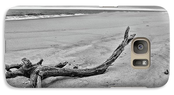 Galaxy Case featuring the photograph Driftwood On The Beach In Black And White by Paul Ward