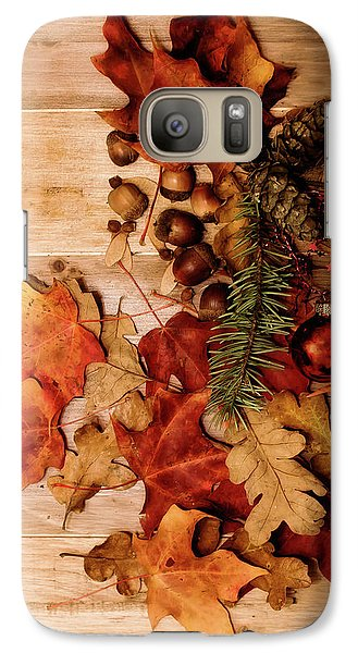 Galaxy Case featuring the photograph Leaves And Nuts And Red Ornament by Rebecca Cozart