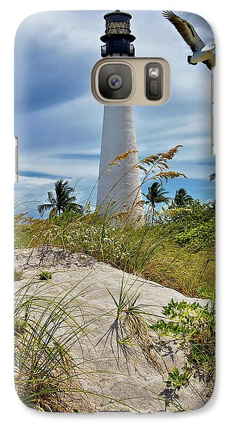 Galaxy Case featuring the photograph Pelican Flying Over Cape Florida Lighthouse by Justin Kelefas