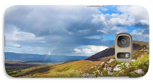 Galaxy Case featuring the photograph Raining Down And Sunshine With Rainbow On The Countryside In Ire by Semmick Photo