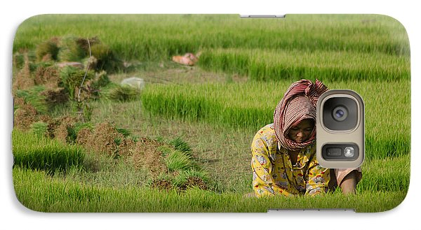 Galaxy Case featuring the photograph Rice Field Worker Harvests Rice In Green Field In Southeast Asia by Jason Rosette