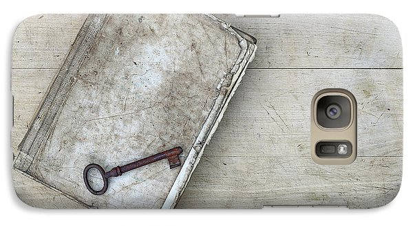 Galaxy Case featuring the photograph Rusty Key On The Old Tattered Book by Michal Boubin