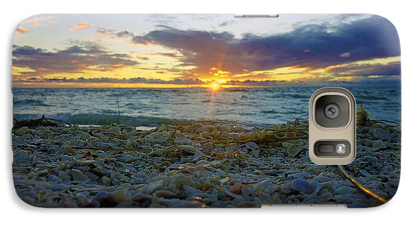 Galaxy Case featuring the photograph Shells On The Beach At Sunset by Robb Stan