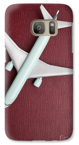 Galaxy Case featuring the photograph Toy Airplane Over Red Book Cover by Edward Fielding