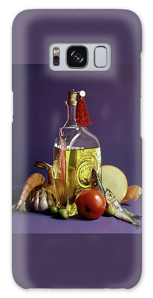 A Bottle Of Olive Oil Surrounded By A Variety Galaxy Case