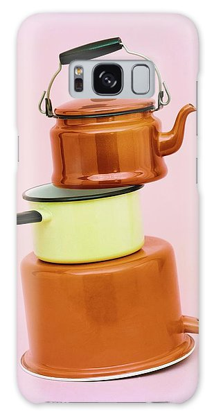 A Brass Teapot Stocked On Top Of Pots Galaxy Case