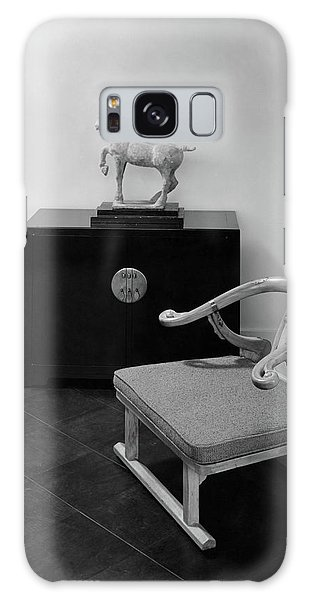 A Chair, Bedside Cabinet And Sculpture Of A Horse Galaxy Case