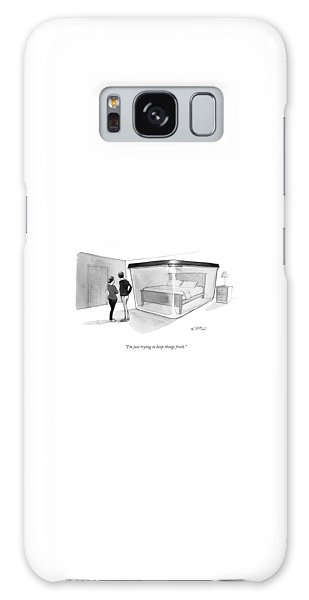 A Couple Looks At A Bed Encased In A Giant Galaxy Case