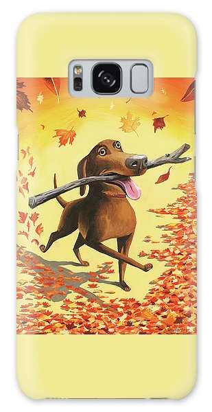 A Dog Carries A Stick Through Fall Leaves Galaxy Case