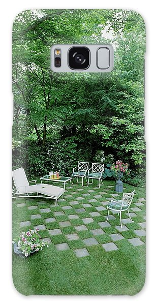 A Garden With Checkered Pavement Galaxy Case