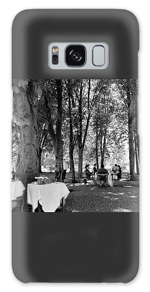 A Group Of People Eating Lunch Under Trees Galaxy Case