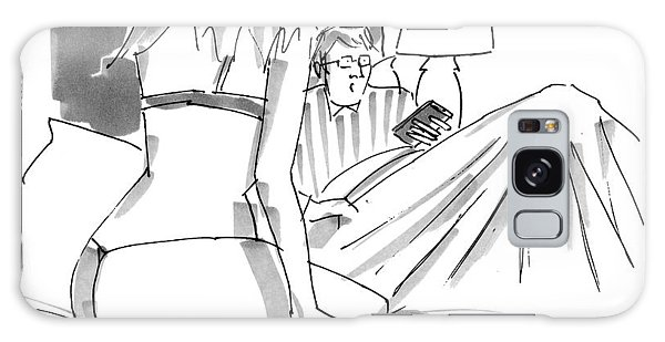 A Man In Bed With Remote Control  In Hand Ignores Galaxy Case