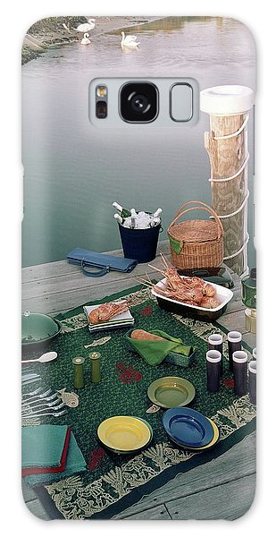 A Picnic Set Up On A Dock Galaxy Case