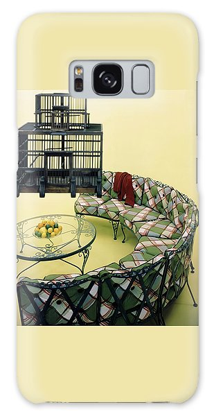 A Round Couch And A Birdcage Galaxy Case