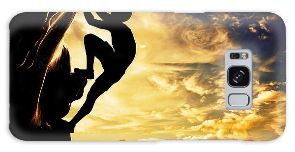 A Silhouette Of Man Free Climbing On Rock Mountain At Sunset Galaxy Case