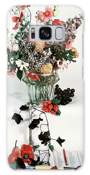 A Studio Shot Of A Vase Of Flowers And A Garden Galaxy Case