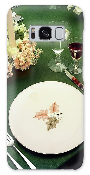 A Table Setting On A Green Tablecloth Galaxy Case