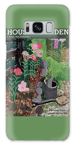 A Watering Can And A Shovel By A Flower Bed Galaxy Case