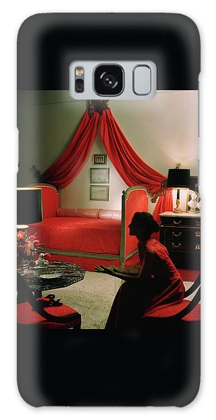 A Young Woman Sitting In A Red Bedroom Galaxy Case