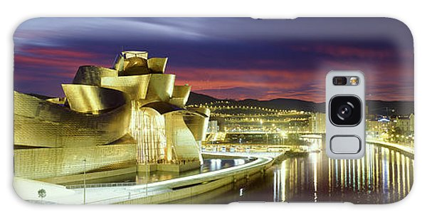 Gehry Galaxy Case - Buildings Lit Up At Dusk, Guggenheim by Panoramic Images