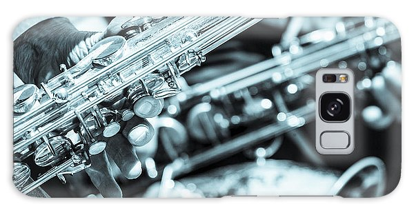 Close Up Of Saxophonist Fingering Galaxy Case