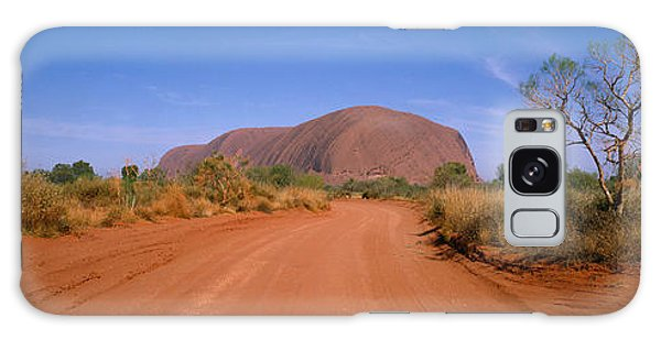 Expanse Galaxy Case - Desert Road And Ayers Rock, Australia by Panoramic Images
