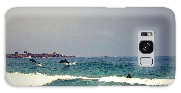 Dolphins Swimming With The Surfers At Asilomar State Beach  Galaxy Case