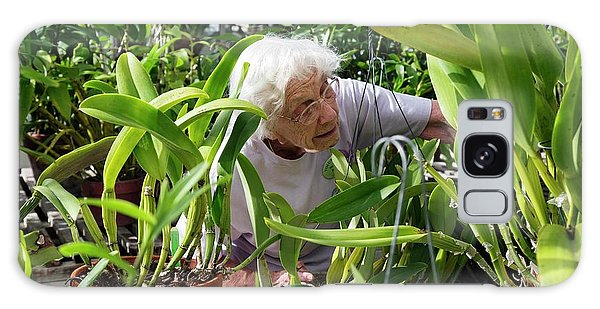 Elderly Woman Examining Plants Galaxy Case by Jim West