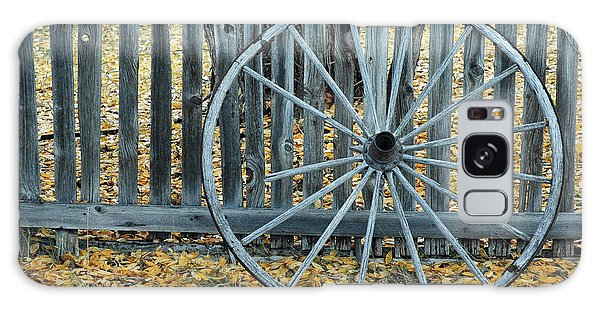 Golden Leaves And Old Wagon Wheel Against A Fence Galaxy Case