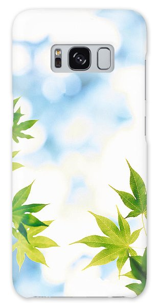 Mottled Galaxy Case - Green Leaves On Mottled Cloudy Sky by Panoramic Images