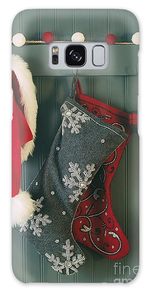 Galaxy Case featuring the photograph Hanging Stockings And Santa Hat On Hook by Sandra Cunningham