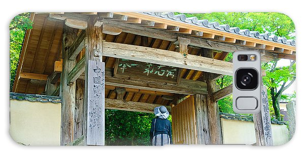 Lady Looking Up At The Impressive Woodwork Of A Japanese Temple Gate Galaxy Case