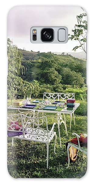 Outdoor Dining Galaxy Case - Outdoor Furniture By Lloyd On Grassy Hillside by Tom Leonard
