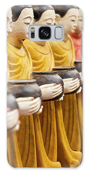 Alms Galaxy Case - Row Of Buddhist Monk Statues Holding by Peter Adams