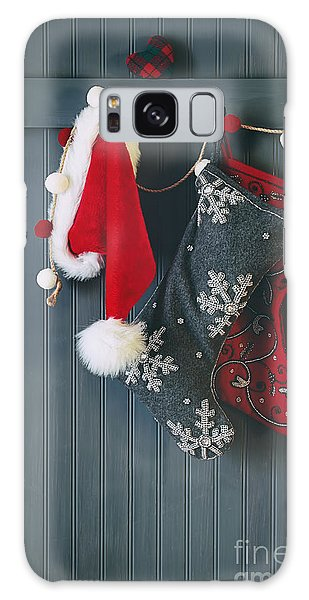 Galaxy Case featuring the photograph Stockings Hanging On Hooks For The Holidays by Sandra Cunningham