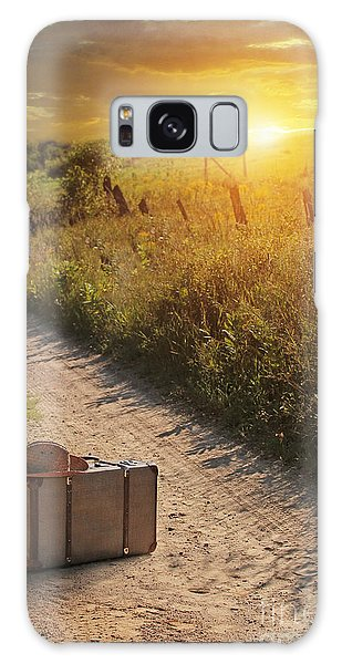 Galaxy Case featuring the photograph Suitcase With Hat On Road At Sunset by Sandra Cunningham