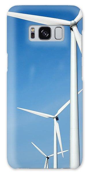 Three Mighty Windmills In A Row Against A Blue Sky. Galaxy Case
