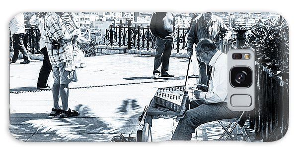 tourists watching busker playing santoor dulcimer at Tarragona S Galaxy Case