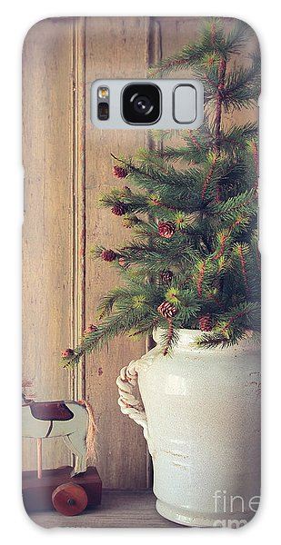 Galaxy Case featuring the photograph Toy Horse With Christmas Tree On Table by Sandra Cunningham