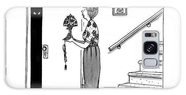 Woman Holding Lamp Stands At Dark Bedroom Doorway Galaxy Case