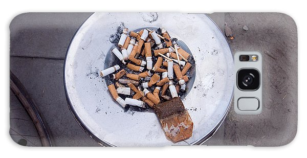 A Lot Of Cigarettes Stubbed Out At A Garbage Bin Galaxy Case by Ashish Agarwal