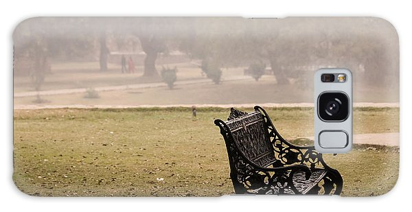 A Wrought Iron Black Metal Bench Under A Tree In The Qutub Minar Compound Galaxy Case by Ashish Agarwal