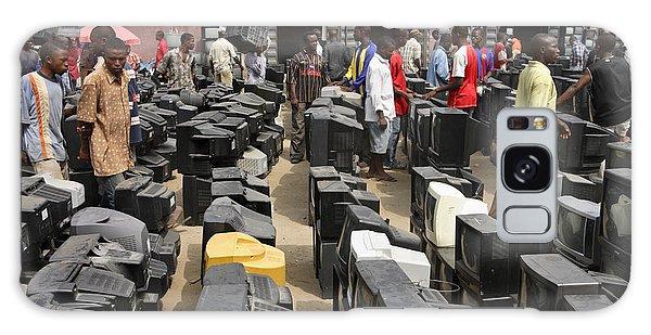 Nigeria Galaxy Case - At Alaba Market, Prospective Buyers by Peter Essick