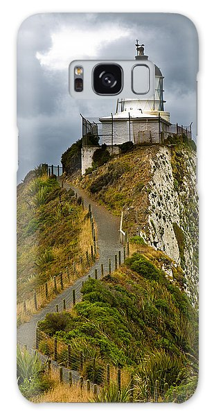 Nugget Point Light House And Dark Clouds In The Sky Galaxy Case
