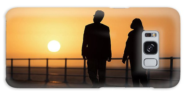 A Couple In Silhouette Walking Into The Sunset Galaxy Case