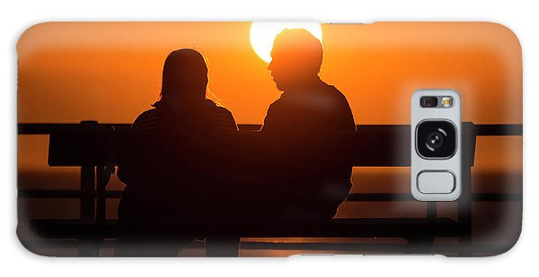 A Couple Sitting At Sunset Galaxy Case